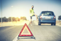 Emergency triangle on the road. Royalty Free Stock Photography