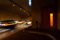 Emergency in the tunnel. Car racing and emergency point in the tunnel Royalty Free Stock Photography