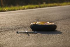 Emergency tyre on the road Stock Image