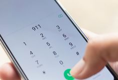 Emergency and urgency, dialing 911. On smartphone screen. Shallow depth of field royalty free stock images