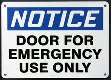 Emergency Use Door Sign stock photo