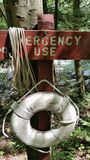 Emergency Use. A lifesaving ring is beside the fast moving river Stock Images
