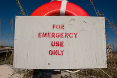 For Emergency Use Only Sign on Life Buoy. With aged sign royalty free stock photography