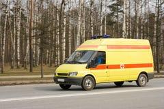 Emergency van. Rides by a park Stock Photos
