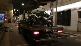Emergency vehicle loading on a tow truck stock video footage