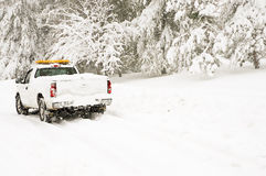Emergency vehicle in snowstorm Royalty Free Stock Photos