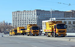 Emergency vehicles of municipal services in Moscow. Emergency vehicles of municipal services drive through on Bolshoy Ustinsky Bridge in Moscow Stock Images
