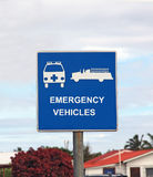 Emergency Vehicles Traffic Sign. With  ambulance and fire truck on a blue background Stock Photos
