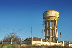 Emergency Water Tank. Elevated over a mortar structure Stock Photography