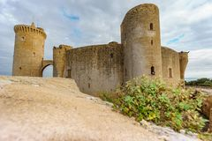 Bellver Castle in Majorca. Emerging of Bellver Castle against cloudy sky in Majorca Royalty Free Stock Images
