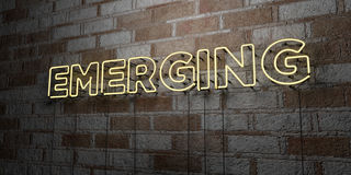 EMERGING - Glowing Neon Sign on stonework wall - 3D rendered royalty free stock illustration Stock Image