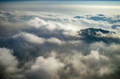 Emerging peak above clouds Royalty Free Stock Images
