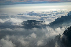 Emerging peaks among the clouds Royalty Free Stock Photo
