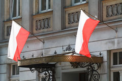 Emerging Polish flags on building, close up Stock Photography