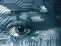 Emerging technologies. Eye of woman overlaid on to circuit board abstract