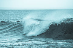 The emerging wave of the sea near the coast. Royalty Free Stock Photos