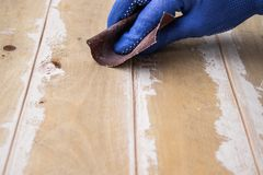 Emery paper rubs the board. Grinding boards before painting royalty free stock photography