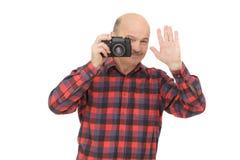 Emeryt z photocamera robi krótkopędu zdjęcia royalty free