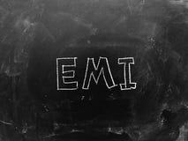 EMI Handwritten sulla lavagna fotografie stock