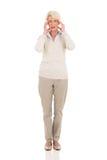 Emicrania della donna invecchiata mezzo Fotografie Stock