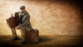 Emigrant with cardboard suitcases. Royalty Free Stock Photography