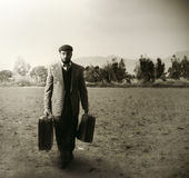Emigrant with the suitcases stock photo