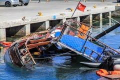 Emigrantes virados do barco Imagens de Stock Royalty Free