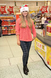 Emily Atack. Celebrities surprise Morrisons shoppers by packing their bags  to raise money for ITVs charity appeal, Text Santa London. 12/12/2013 Picture by Royalty Free Stock Image