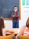 Eminent boy in front of class Royalty Free Stock Image
