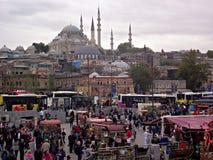 Eminonu Arena, Istanbul Suleymaniye Mosque. Eminonu arena & Suleymaniye mosque, People,   Fish, pickle juice & Corn vendors on arena Royalty Free Stock Photo