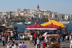 Eminonu Harbor, Beyoglu district historic architecture and sea port over the Golden Horn bay in Istanbul, Turkey Royalty Free Stock Photography