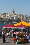 Eminonu Harbor, Beyoglu district historic architecture and sea port over the Golden Horn bay in Istanbul, Turkey Royalty Free Stock Photo