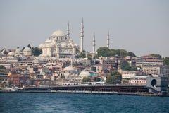 Eminonu Harbor, Beyoglu district over the Golden Horn bay in Istanbul, Turkey Royalty Free Stock Photography