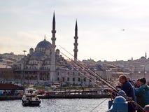Eminonu - Istanbul. People fishing across Valide Sultan Mosque.  December, 2008. Istanbul - Turkey Stock Image