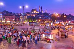 Eminonu quayside in Istanbul in the evening Royalty Free Stock Photography