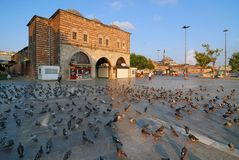 Eminonu Square of Istanbul. Egyptian Bazaar and pigeons, very early in the morning Stock Photography