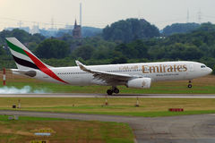 Emirates Airbus A330 landing. Emirates is the flag carrier of Dubai. The company is growing fast with a current (Jul'11) fleet of 155 aircrafts but almost more Royalty Free Stock Image