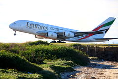 Emirates Airbus A380 takes off. Emirates Airbus A380 takes off from Sydney Airport, Australia.  Photo taken 8 June 2009 Stock Photo