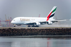 Emirates Airbus A380 takes off in the rain. Emirates Airline is looking at postponing delivery of new A380 aircraft to ease a manufacturer backlog. Photo taken Royalty Free Stock Photography