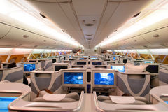 Emirates Airbus A380 business class interior. HONG KONG - JUNE 18, 2015: Emirates Airbus A380 business class interior. Emirates is one of two flag carriers of Stock Image