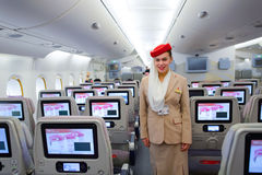 Emirates Airbus A380 crew member. HONG KONG - MARCH 10, 2015: Emirates Airbus A380 crew member. Emirates handles major part of passenger traffic and aircraft Royalty Free Stock Photo
