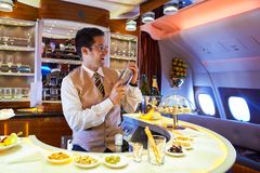 Emirates Airbus A380. DUBAI, UAE - MARCH 31, 2015: interior of Emirates Airbus A380. Emirates is one of two flag carriers of the United Arab Emirates along with Royalty Free Stock Photography