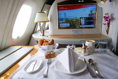 Emirates Airbus A380. DUBAI, UAE - MARCH 31, 2015: interior of Emirates Airbus A380. Emirates is one of two flag carriers of the United Arab Emirates along with Stock Images