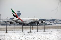 Emirates Airbus A380-800 A6-EEB, Munich Airport MUC. Emirates Airbus A380-800 A6-EEB doing taxi in Munich Airport MUC, winter time with snow on runway Stock Images