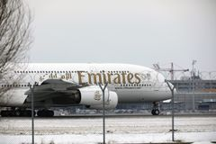 Emirates Airbus A380-800 A6-EEB, Munich Airport MUC. Emirates Airbus A380-800 A6-EEB doing taxi in Munich Airport MUC, winter time with snow on runway Stock Photos
