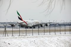 Emirates Airbus A380-800 A6-EEB, Munich Airport MUC. Emirates Airbus A380-800 A6-EEB doing taxi in Munich Airport MUC, winter time with snow on runway Stock Photography