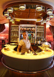 Emirates Airbus A380 in flight cocktail bar and lounge. DUBAI, UAE - FEBRUARY 7, 2016: Emirates Airbus A380 in flight cocktail bar and lounge. Emirates is one of Royalty Free Stock Image