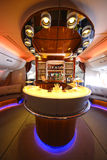 Emirates Airbus A380 in flight cocktail bar and lounge. DUBAI, UAE - FEBRUARY 7, 2016: Emirates Airbus A380 in flight cocktail bar and lounge. Emirates is one of Royalty Free Stock Images