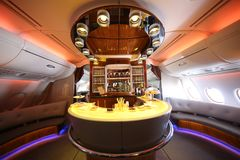 Emirates Airbus A380 in flight cocktail bar and lounge. DUBAI, UAE - FEBRUARY 7, 2016: Emirates Airbus A380 in flight cocktail bar and lounge. Emirates is one of Stock Photos