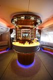 Emirates Airbus A380 in flight cocktail bar and lounge. DUBAI, UAE - FEBRUARY 7, 2016: Emirates Airbus A380 in flight cocktail bar and lounge. Emirates is one of Stock Image